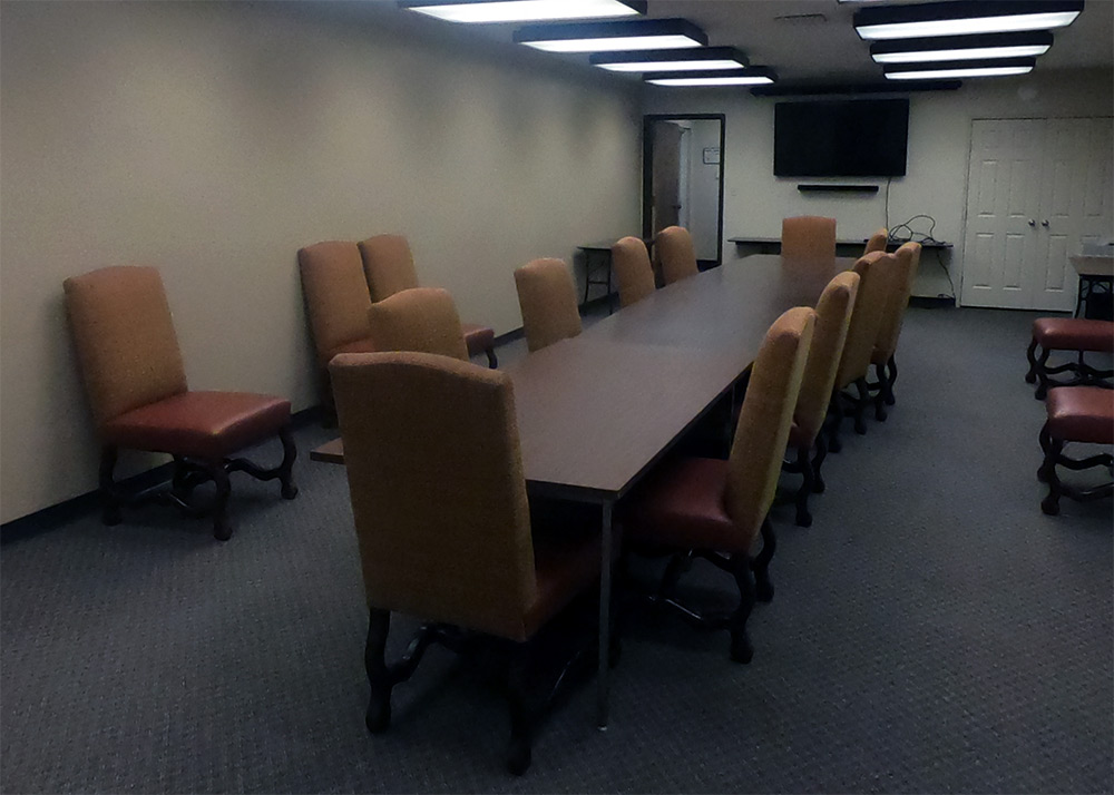 A conference room with a dozen tables around it
